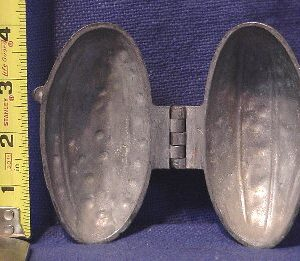 pewter ice cream mold of cucumber pickle