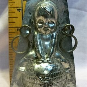 old vintage antique chocolate mold Kewpie on world