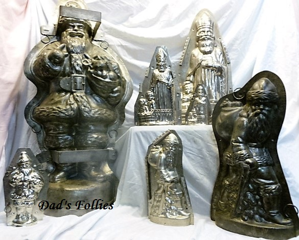 antique old vintage metal chocolate molds santas for sale