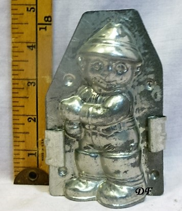 old metal vintage antique chocolate mold for sale boy fishing