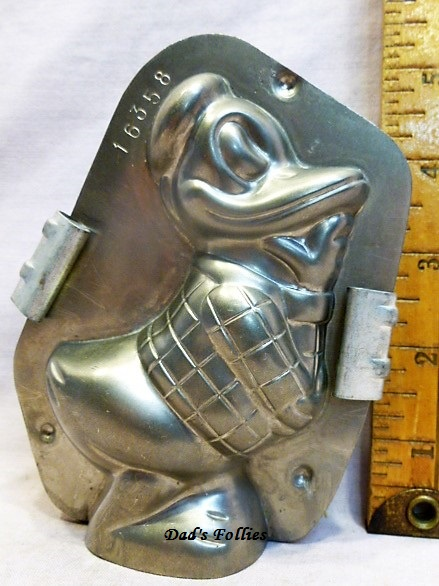 old antique metal vintage chocolate mold for sale Donald duck